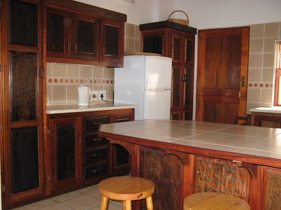 Kitchen cupboards made of sleepers