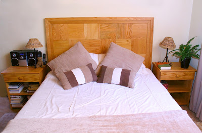 This modern headboard and bed pedestals are made of solid red oak. The headboard consists of square wooden blocks