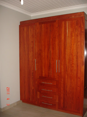 Built-in wardrobe made of rosewood with four drawers and a lot of storage space