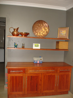 Built-in sideboard made of rosewood with solid top and floating shelves