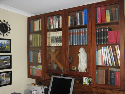 Built-in book-shelf for the study. The frames of the glass doors are made of solid kiaat