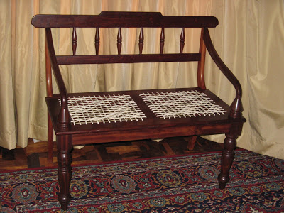 "Old-fashioned double ""riempie"" seat . This is a precise replica of the original chair from days of yore. This specimen was made of railway sleepers"