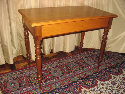 Yellow-wood table with stinkwood legs. The top was replaced and the table renovated