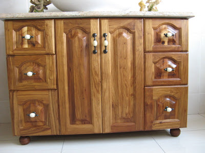 Elegant kiaat cupboard for wash basin