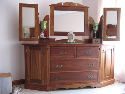 Large dressing-table made of kiaat with drawers and extra storage space at the sides
