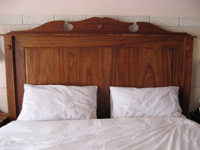 Large headboard of solid kiaat that goes with the dressing table and bed pedestal