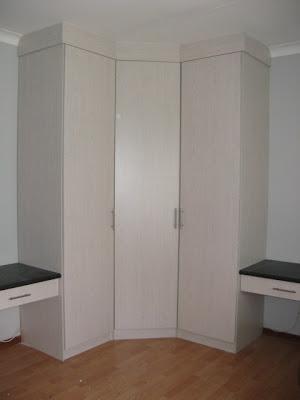 Corner-cupboard made of black cherry (melamine) with two desks for children's room.