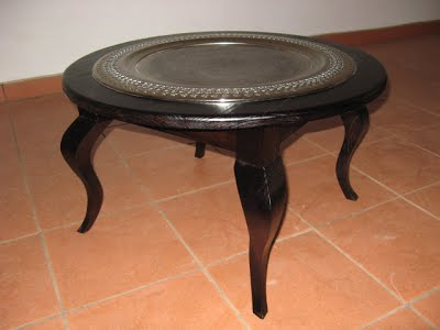 Round coffee table with metal tray sunk into the top