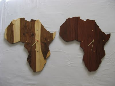 Wall clocks made of tamboti (left) and dark sleeper wood (right)