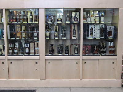 Three of the five sections of a 4.7 meter wide liquor cabinet made of beech-wood (Makro Wonderboom)