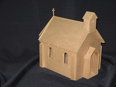 Model of a small church. This little church can only seat twelve people