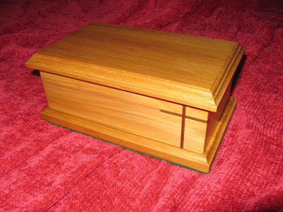 Jewel box made of yellow wood with embuia cross. The lid is loose and not fixed with hinges