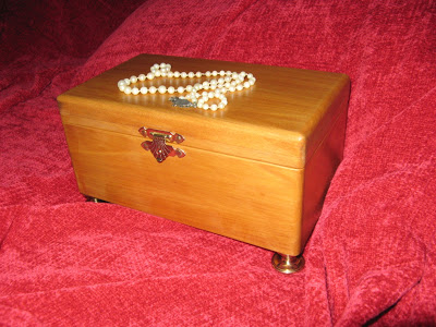 Yellow wood jewel box with brass legs, hinges and clasp