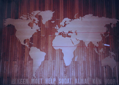Large world map cut by hand from 3mm ply wood (teak finish).  This piece can be viewed in front of the Dutch Reformed Church Wonderboompoort.
